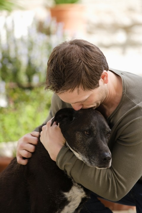 028367010-man-hugging-dog2-480x720